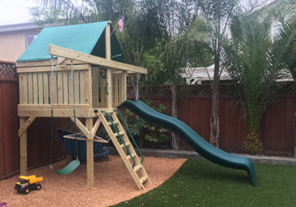 The Pathfinder Swing Set Space Saver Edition from The SwingSet Co. is great for family time and friends for outdoor play. It is a great small backyard playset with many accessories including an extra large fort, a belt swing, trapeze bar, 10' wave slide and an under fort hammock.
