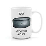 BUSY NOT GIVING A PUCK MUG