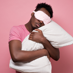 Man with eye mask and pillow