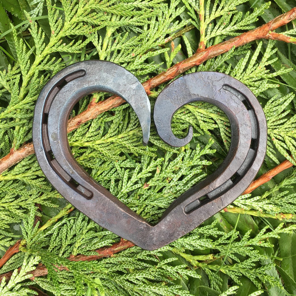 horseshoe heart with an asymmetrical curl for iron anniversary, weddings