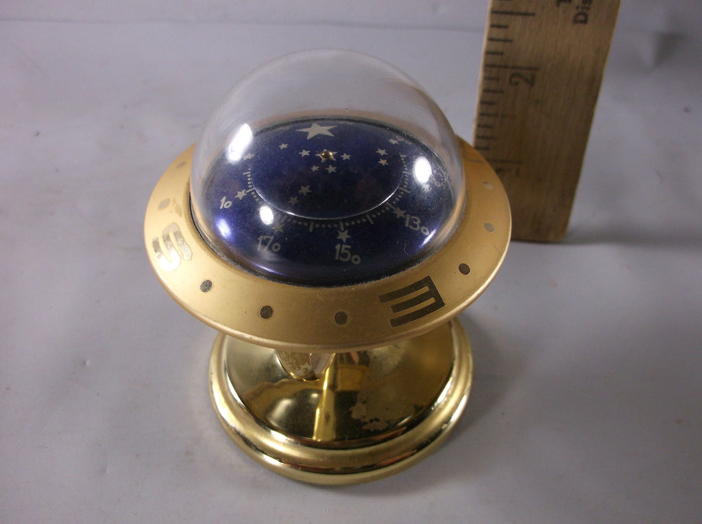 vintage footed mid century desktop compass/paperweight