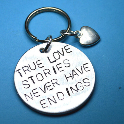 True Love Stories Never Have Endings  Keyring with love quote. A perfect present for anniversary and valentines day. Unique quote stamped by hand into aluminium metal. Make your girlfriend or wife smile! Remind your husband how it all started or buy 2 of these for you and your boyfriend. Let the love shine!