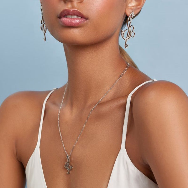 Couture_Kingdom_Fantasia_Treble_Clef_Mickey_Necklace_White_Gold_On_Model