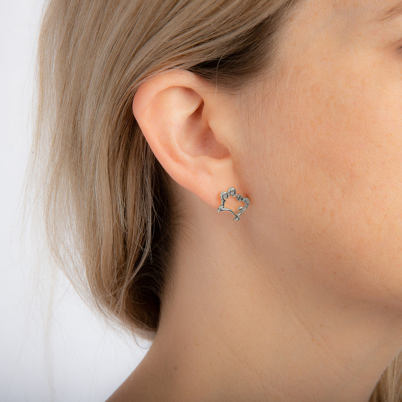 Disney_Couture_Kingdom_Winnie_the_Pooh_earrings_on_model