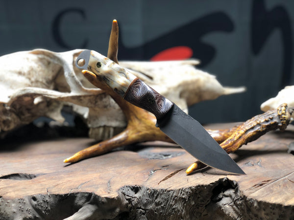 Crow jr blade, giraffe bone split, black palm, natural micarta split, brass pin striping, black g10 liners, mosaic pins,