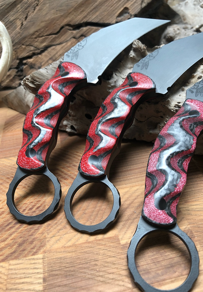 Karambito blades, matte black cerakote, red and black lightning carbon fiber, textured grip , carbon fiver pins,