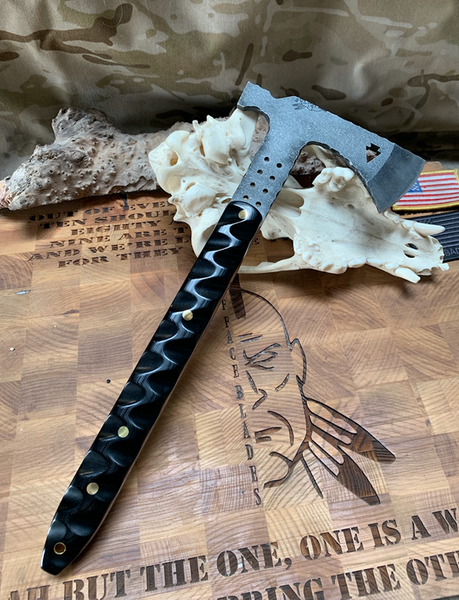 Arrowhead hawk/hatchet, black G10 textured grip, black, red and brass liners, solid brass pins, hollow brass lanyard pin,