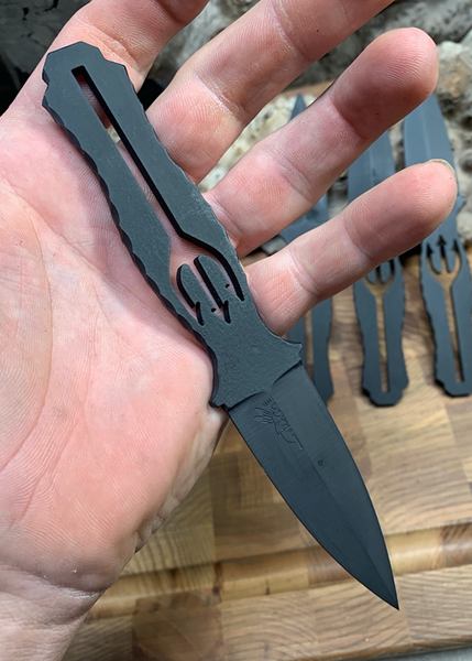 Trident dagger, matte black cerakote, rock work around grip,