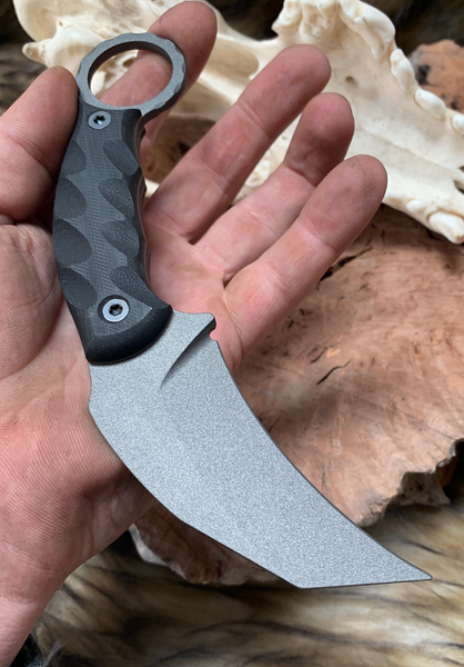 Karambito blade, black G10 lighting grip, gun metal grey cerakote, black bolts, grey G10 liners,