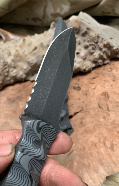 Disaster Jr blade, cerrated, MAS grey and black layered G10 textured grip, carbon fiber pins, open tang,