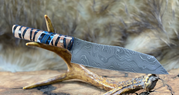Santoku chef blade, damascus, natural maple burlwood split, blue pearl resin river throughout, blue black pearl resin with glacier storm carbon fiber, white and brass pin striping, mosaic pins,
