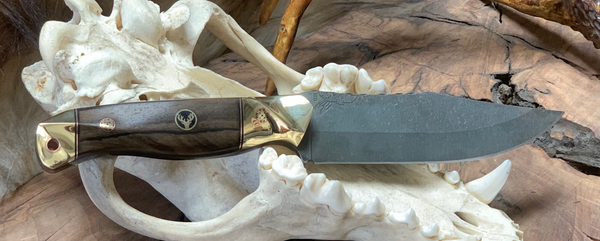 Crow scout blade, brass bolster and pommel, Ziricote wood center, copper and black G10 liners, elk mosaic pin, copper lanyard pin,