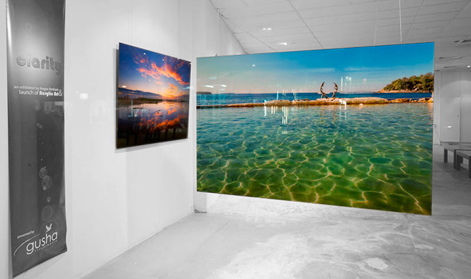 Two 1500x1000mm acrylic face mount pictures on display in an exhibition.