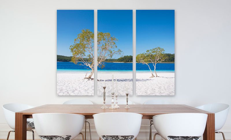 Stretched Canvas Triptych Hung Above a Dining Table