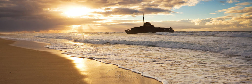 The wreck of the MV Sygna photographed at sunrise from Stockton Beach.