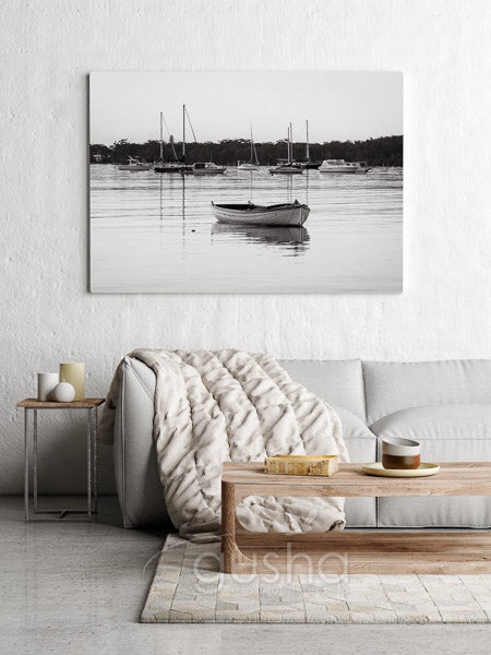 Nautical black and white print on canvas above sofa