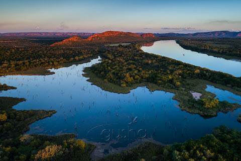 The last light of day bathes the quiet tributaries of Lake Kununurra.