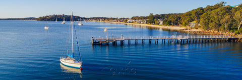 Captured near Soldiers Point, this photo shows Salamander Bay wharf with Wanda Beach on the horizon.