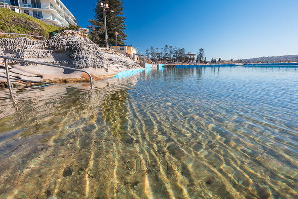A photo of clear sparkling water at the edge of Dee Why Pool in Sydney, Australia.
