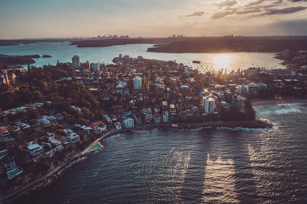 The setting sun casts long shadows in a photo captured high over Manly in Sydney, Australia.
