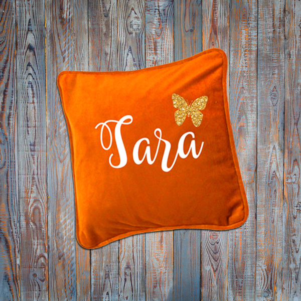 Orange cushion with name and butterfly