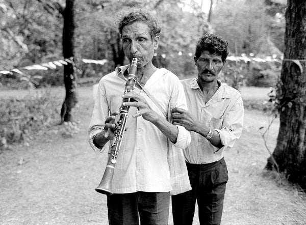 Karan Kapoor, Blind musician being led at a local feast, Loutolim, Goa, 1994