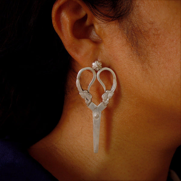 Chic designer silver earrings worn by model