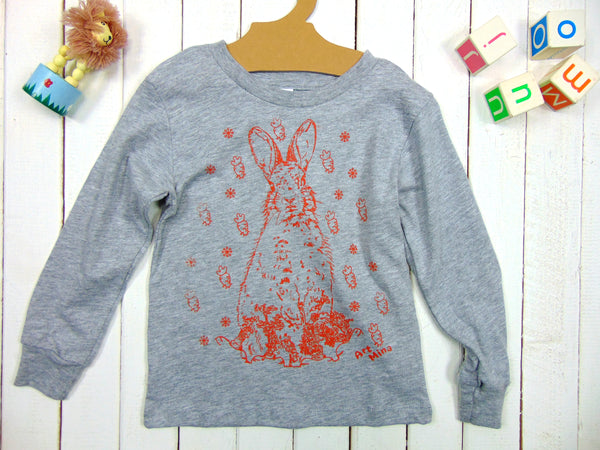 "A photo of Art Mina Kids Long Sleeve T-shirt ""Bunny Carrot"""