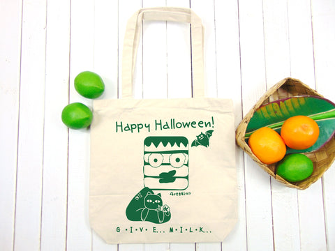 "A photo of Art Mina Medium Canvas Tote Bag ""Cat Lover Frankenstein - GIVE .. MILK..."""