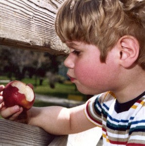 The author as a boy, considering the mysteries of the apple.