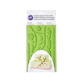 WILTON Silicone Fondant and Gum Paste Mold with Nature Designs