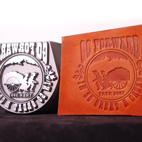 Closeup view of Custom Leather Hand Stamp and impression