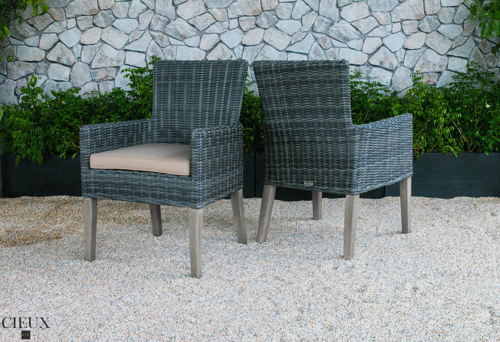 champagne weathered teak table with six grey wicker chairs cieux