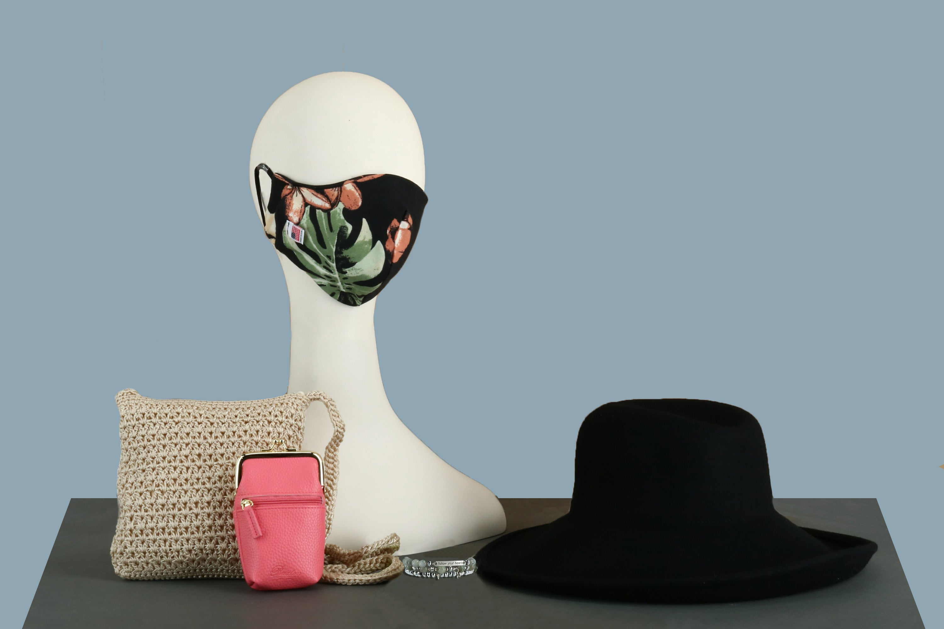 Floral face mask, black hat, knitted handbag and pink coin purse at BeltOutlet.com