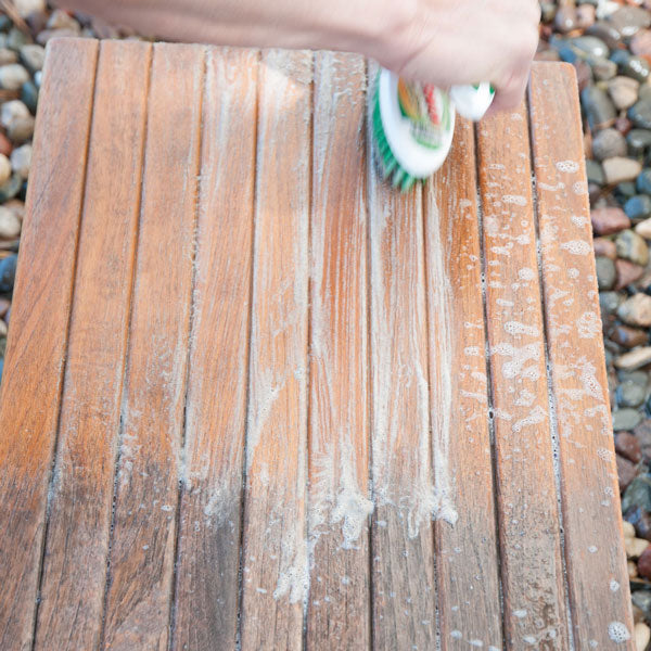 Step 4 : Spray on more Teak Cleaner and brush the surface again