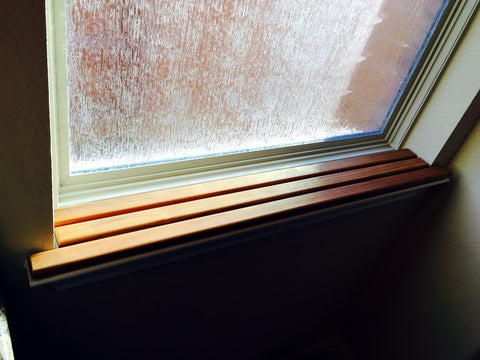 Small teak insert for sprucing up a window sill.