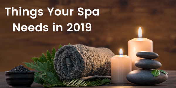 spa towels with candles and hot stones