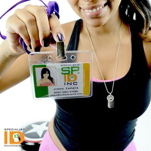 Girl holding ID badge in the 1815-1000 badge holder presenting ID.