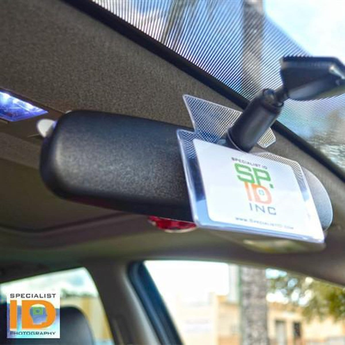 Hang Tag Holder shown on rear view mirror of car