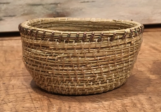 Artist Cree Stevens pine needle basket with beads