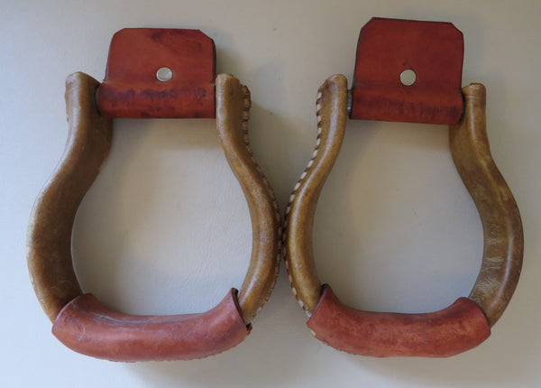 7914 Lightly Used Rawhide Covered Flat Bottom Iron Stirrups