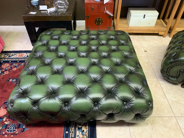 tufted stool in green leather