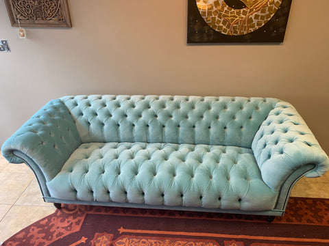 tufted sofa in pale blue velvet