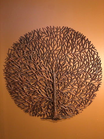 bronze round tree of life made in haiti from recycled oil drums