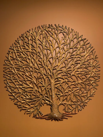round gold tree of life made in haiti from recycled oil drums
