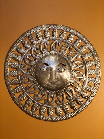 embellished sun made in haiti from recyled oil drums