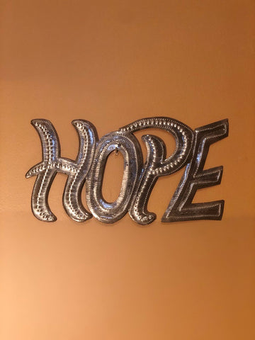 hope sign made in haiti from recycled oil drums