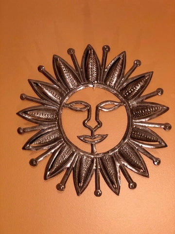 happy sun made in haiti from recycled oil drums