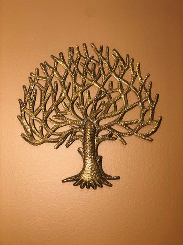 gold tree of life made in haiti from recycled oil drums