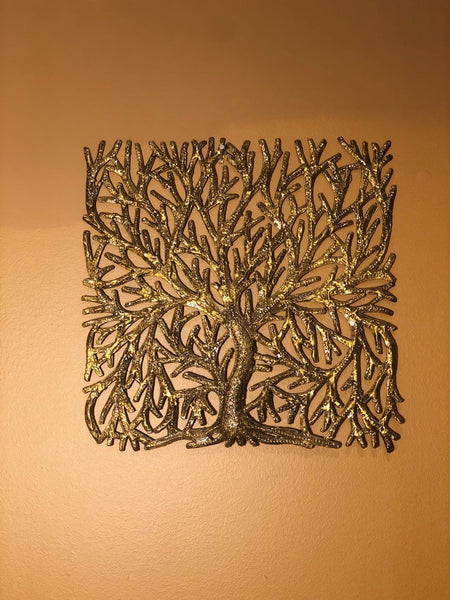 gold finished tree of life, made in haiti from recycled oil drums